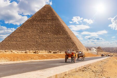 Carriage on the road near the Pyramid of Cheops, Giza, Egypt.