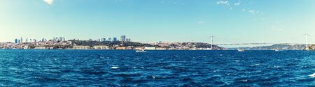 Istanbul sea panorama, business district and Ortakoy Mosque on the background.
