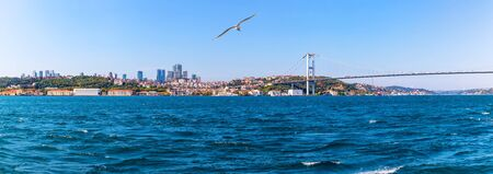 The Boshporus, the 15 July Martyrs Bridge and european bank of Istanbul with the Ortakoy Mosque, Istanbul panorama. Imagens