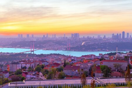 Colors of Istanbul, the Bosphorus bridge and the skyline of the city at sunset.