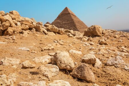Rocks in the Giza desert in front of the Pyramid, Egypt Stock Photo
