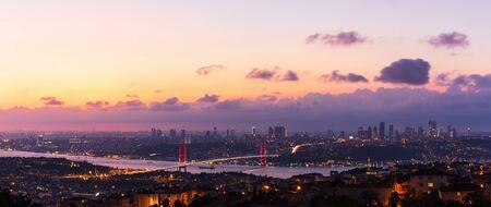The Bosphorus Bridge and the night lights of Istanbul, aerial panorama. Imagens