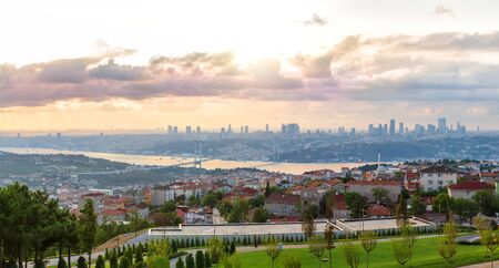 View on the Bosphorus Bridge and Istanbul skyscrappers from Camlica Hill, Turkey.