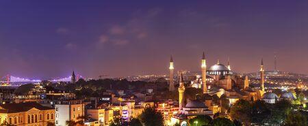 Hagia Sophia and the Bosphorus Bridge, evening panorama of Istanbul.
