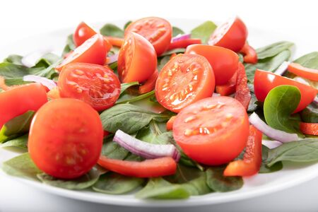 Fresh salad with tomatoes, isolated on white background.