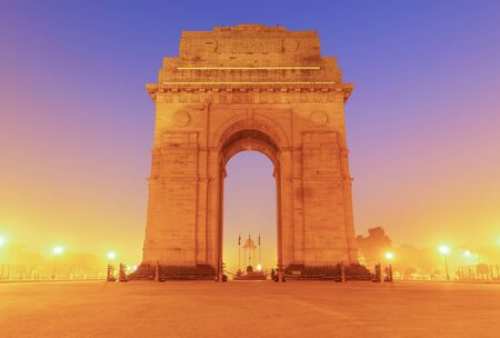 India Gate in yellow evening lights, New Dehli.