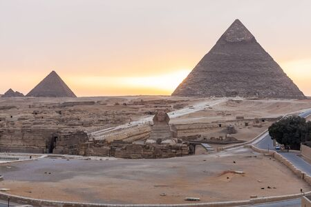 The Sphinx, the Pyramid Of Khafre and the Pyramid of Menkaure in Giza at sunset, Egypt.