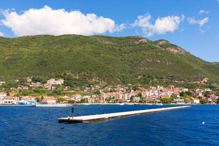 Pier and the shore of the Adriatic sea in the Bay of Kotor, Montenegro