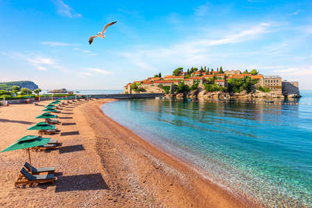 Sveti Stefan island, view from the beach in the Budva riviera, Montenegro. Imagens