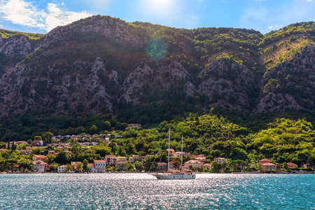 Lonely yacht near the Adriatic coast in the Bay of Kotor, Montenegro. Imagens