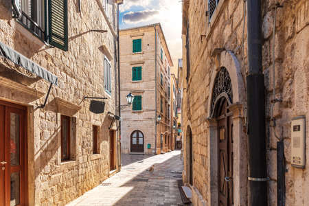 Traditional narrow street in Europe, Old Town of Kotor, Montenegro. Imagens