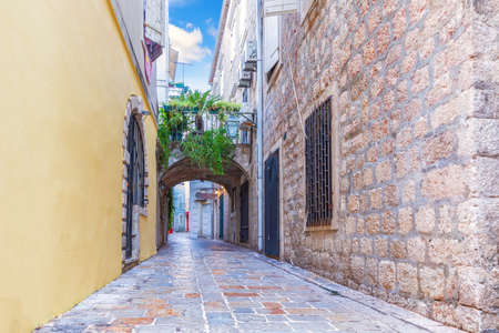 Medieval narrow street in the Old Town of Budva, Montenegro