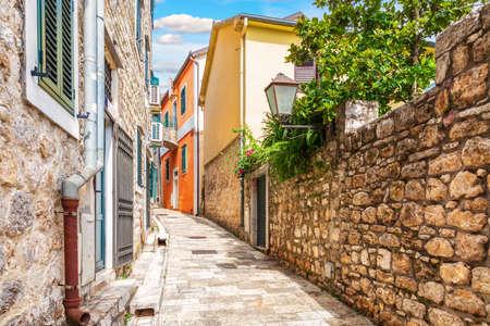 Empty narrow medieval European street in the Old Town of Herceg Novi, Montenegro