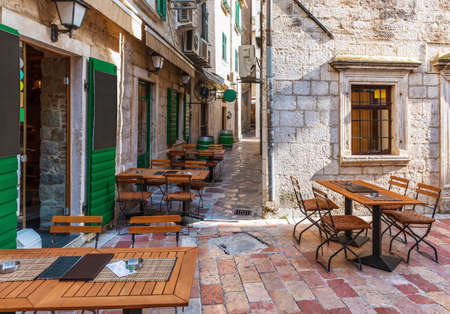 Traditional european cafe in Old Town of Kotor, Montenergo, no people.