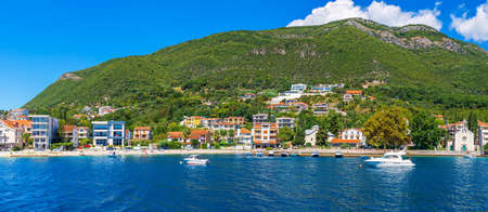 Yacts and houses in the Kotor bay on the shore of the Adriatic sea, Kotor Bay, Montenegro.