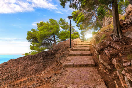 Footpath with steps in the mountains near the Sveti Stefan island, Montenegro