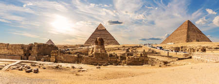 The Great Pyramids of Giza and The Sphinx near the ruins of a temple in Giza, Egypt