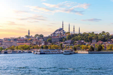 Eminonu Pier near the Suleymaniye Mosque in Istanbul, view from the Bosphorus at sunset.