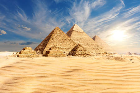 The Pyramids of Giza at sunset in Egypt, the main view