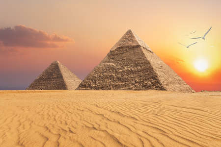 The Pyramid of Chephren and the Pyramid of Cheops, beautiful sunset view of Giza, Egypt.