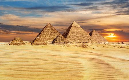 Pyramids of Egypt at sunset, famous Wonder of the World, Giza.