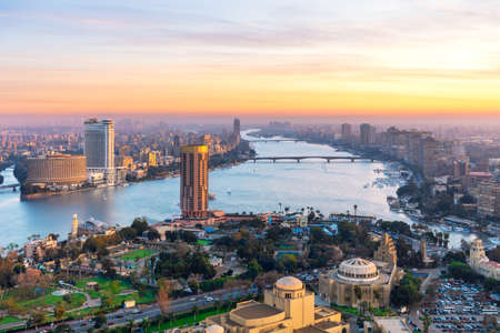 Cairo downtown with Skyscrappers on the Nile at sunset, Egypt.