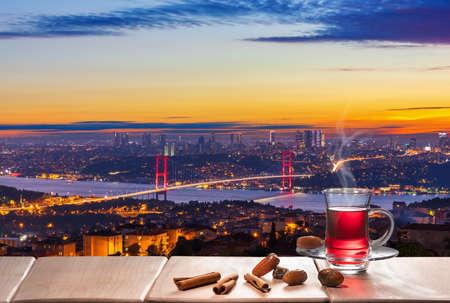 Turkish tea party and The Bosphorus bridge at night, Istanbul.