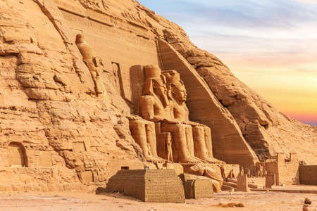 Abu Simbel, Egypt, view of the Great Temples colossal statues, sunset light 免版税图像