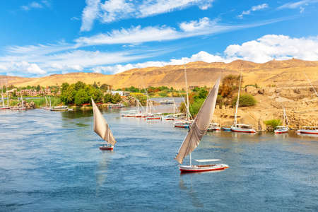 The Nile view, feluccas and banks of Aswan, Egypt