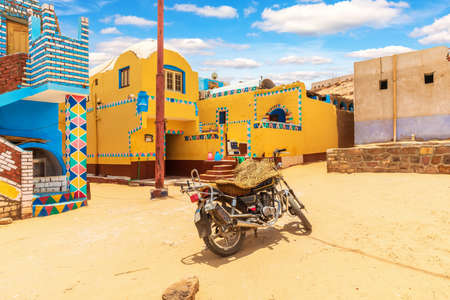 Traditional Nubian village in Africa and an authentic motorbike, Egypt