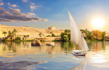 The Nile and traditional African village near Aswan, Egypt.