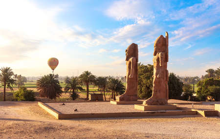 Colossal statues near Mortuary Temple of Thutmose III, Luxor, Egypt. 免版税图像