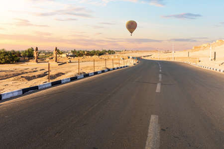 Road to the Mortuary Temple of Hatshepsut and air baloons, Luxor, Egypt.