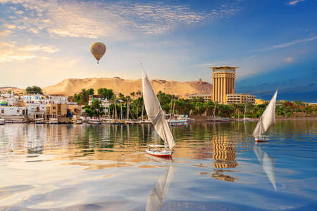 Aswan river scenery with air baloons, beautiful Nile view, Egypt.