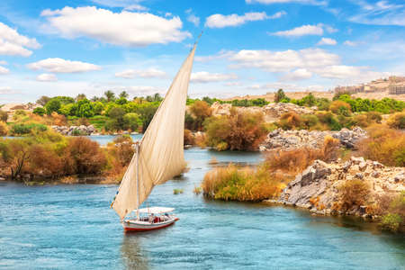 Aswan in Egypt, traditional felucca in lake Nasser of the Nile.