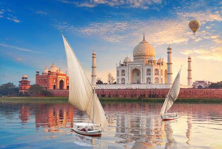 Taj Mahal and sailboats with air baloons in the Yamuna, Agra, Uttar-Pradesh, India