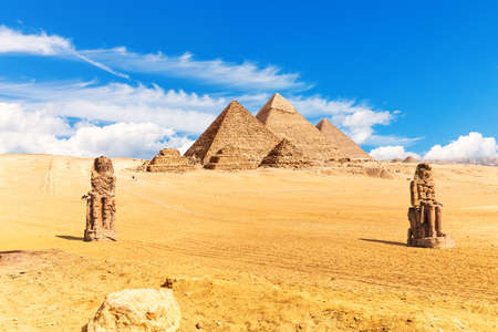 Pyramids of Egypt and the Colossi of Memnon in the desert of Giza