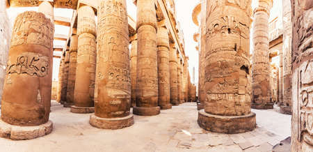 Karnak Temple columns with ancient carvings, Luxor, Egypt.