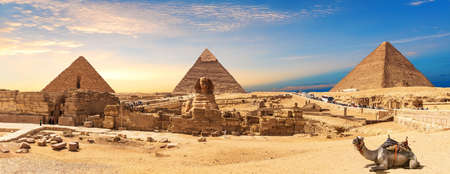 Giza Pyramids and Sphinx panorama with a camel lying by, Cairo, Egypt.