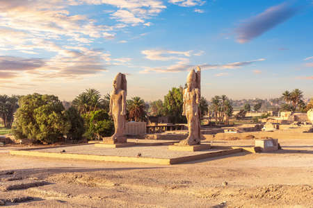 Colossal statues on the way to the Valley of kings, Luxor, Egypt.