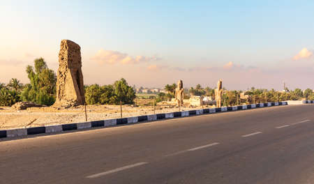 Road to the Valley of Kings and ancient Egyptian statues and tombs on the way, Luxor.