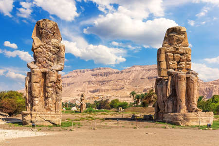 The Colossi of Memnon in the Theban Necropolis, statues of the Pharaoh Amenhotep, Luxor, Egypt.