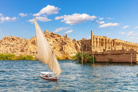 Felucca by the Temple of Philae on the Agilikia island, the Nile, Aswan, Egypt