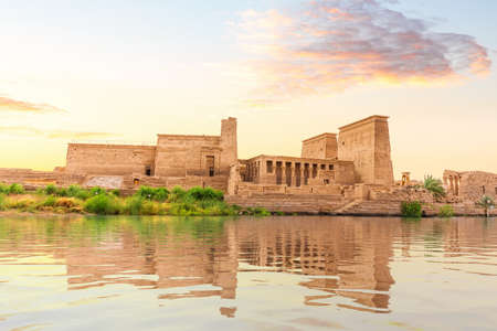 Temple of Isis on Philae Island at sunset, view from the Nile, Aswan, Egypt 版權商用圖片
