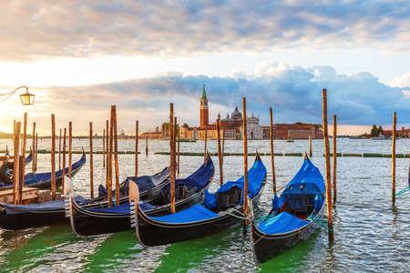 Gondolas moored in front of San Giorgio Maggiore Island in the lagoon of Venice, Italy