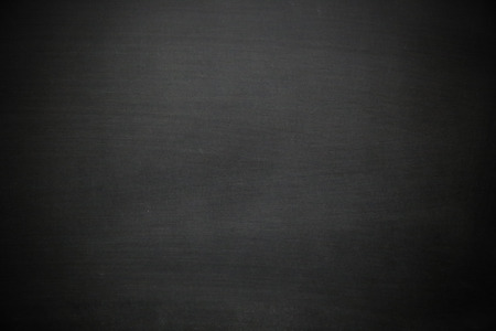 Abstract chalk rubbed out on empty bright and beautiful black blackboard - Can be used for add text, ad, content, graphic design for sale, present, promote your food menu or product - Business concept