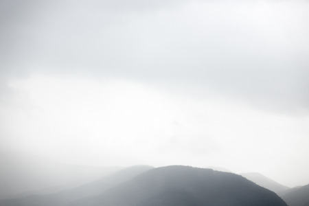 Vanishing mountains in the clouds