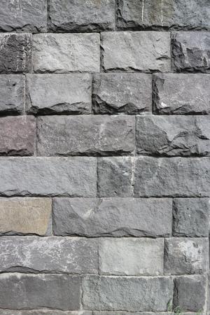 Rubble gray rectangular stone wall, rubblework.