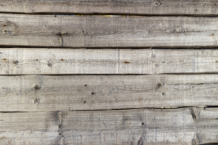 Wooden fence of horizontal planks on a sunny day. Stok Fotoğraf