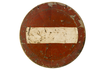 Old scratched round red road sign Do not enter isolated on white.